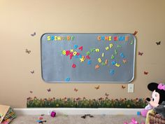 Oil pan for magnet board and cute wall vinyl flowers and butterfly's! :)