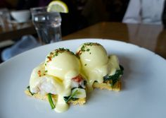 // Lobster, garlic-lemon spinach, slow-poached eggs, and bacon hollandaise