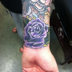 Purple rose on my wrist to cover up an old tattoo I had. Done by Steven Johns @ black umbrella art studio in Huntington Beach, CA