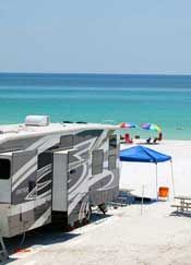 This is the campground we stay at every year in Destin, Florida! Beautiful beaches, gated campground and awesome people!!!    I'd go here :)