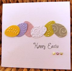clean and simple ... row of die cut Easter eggs with embossing folder textures