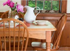 A lovely dining arrangement. The pink flowers + Cherry wood turned leg dining table create a stunning space to have breakfast.