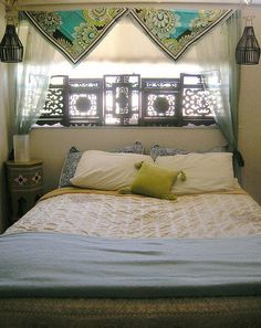 Bohemian Chic Bedroom - love wooden screens, side table and scarves