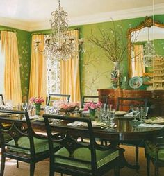 Designer: Mary McDowell-  adore green and yellow combo!  Love the idea of a green dining room- the furniture is beautiful, the gold mirror is awesome, chandelier= gorgeous, and like the seat cushions too!