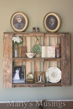 Decorate DIY pallet shelves with precious old photos & knickknacks.