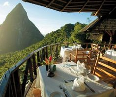 Rise to incredible views of St. Lucia's twin Piton hills at the 32-cottage Ladera Resort.