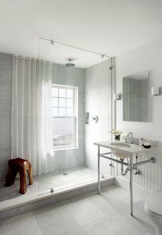 frameless glass, pedestal sink, and teak wood shower stool.
