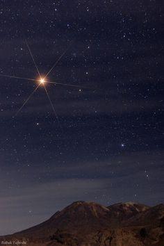 Mars shines over Mt. Taftan in Iran. Unreal.
