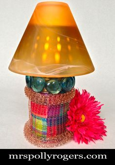 Click here to DIY this Tin Can Votive Lamp.  Fast, Cheap & Easy!  Great for parties, weddings, events.  Choose your own fabric!  Blog & Photos from MrsPollyRogers.com