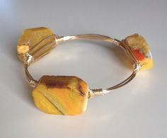 Lovely piece. Gold Wire and Yellow Agate Stone Bangle by Queen Bee CreativeCo, $28.00