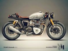Triumph Bonneville Cafe Racer - black fuselage with white lettering of triumph & a green clover on one side