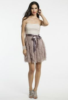 The reasons why you'll love this dress are short and sweet… it's chic, super adorable, and it's the perfect pick for homecoming 2013! This strapless party dress is complete with a ruched bodice, full mesh ruffle skirt, and a pretty ribbon tie waist so, we ask you, What's not to love!