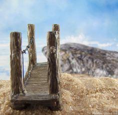 A mini fairy bridge on the fairy garden beach.