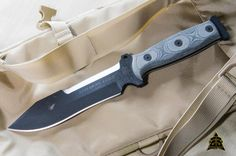 "O/A Length: 11 1/2"" Lower Cutting Edge: 5 5/8"" Upper Cutting Edge: 2 1/2"" Thickness: 1/4"" Weight: 22oz Blade Steel: 5160 Blade Color: Black Traction Coating Handle Material: Black Linen Micarta® Sheath: Combat Ballistic Nylon Mfg. Handcrafted in the USA"