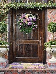 Grace your door with breathtaking florals in vibrant color with the Purple Hydrangea Wreath; an arrangement so lifelike, it looks real.