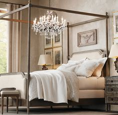 hmmm. a refined canopy with very light drapes just at the four corners? fun chandelier hanging  over bed