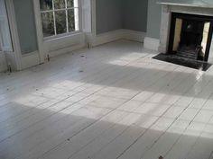 Painted wood floors in white.