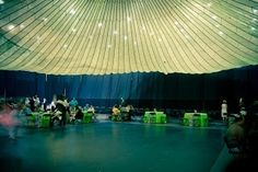 Got a simple venue with a high ceiling... consider renting a parachute!  This couple paid $35 for the rental and with a few twinkle lights, ...