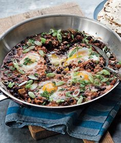 Skillet Poached Huevos Rancheros - An easy, healthy, vegetarian dinner that's a huge hit in my house.