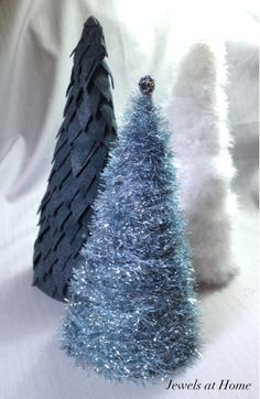DIY felt, feather, and yarn Christmas trees by Jewels at Home.