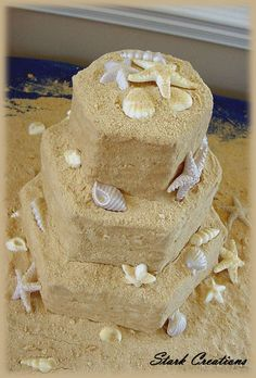 Crushed vanilla wafers and graham crackers pressed into vanilla buttercream icing coated this whimsical cake, while molded chocolate seashells and starfish surrounded the castle. I can only see this for an over the top nautical themed party.