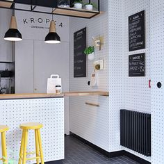 The designers decided to maximise the space by making use of the walls to hold what implements are required, re-appropriating the old workshop favourite pegboard to provide versatile resting places for chopping boards and utensils...
