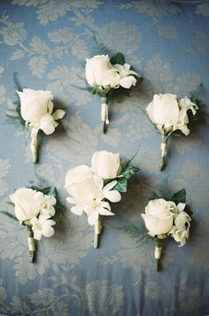 I found small white roses and other small white flowers at Michael's yesterday....if you want silk flowers for the boutineers???