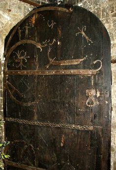 """A door at Stillingfleet Church in Yorkshire dates from 1185. Oldest known working door in England The solid wood door is famous for its Viking ironwork and representations of a Viking ship and other signs meant to act as charms. The exterior door is 4"""" thick solid cedar is still being used today.This Door Is 909 Years Old - Built By The Hand Of Viking Craftsman In 1100 AD."""