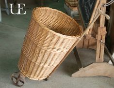 DIY Market cart from Unexpected Elegance- basket, old dolly wheels and cane