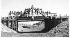 Civilian Conservation Corps in Colorado - Skull Creek, Co., Camp G65C enrollees posed on 30' span bridge, 1940ca,
