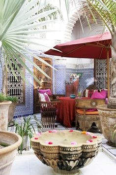 Morocco chic in this courtyard.  I want this fountain!