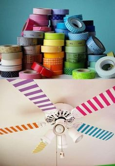 Easy DIY for the kid's room: Decorate the fan with washi tape! They will love the way it looks as it spins!  #diy #householdtips #household #home #kidsroom #ceilingfan #colortape #tape #love #pinterest @Mad4Clips