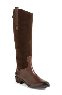 Leather knee-high boots with an equestrian influence.