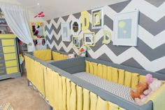 This chevron accent wall is so fantastic in this twins nursery! #nursery #chevron #twins