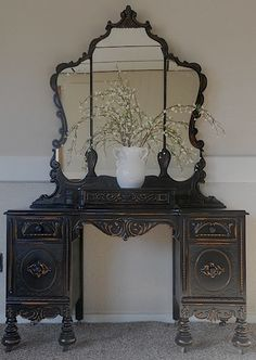 Black Distressed Antique Vanity.  What a fabulous mirror! Get this look with ASCP in Graphite.I found this dresser, still deciding if I should purchase and we make. Now I have a plan for it.