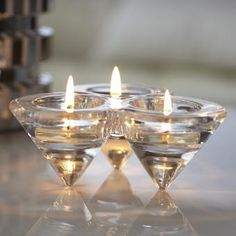 """Diamond Trio Tealight Candle Holder: Sleek cone shapes give our glass candle holder a contemporary edge. Add three tealights, sold separately, for multiple flames. 2""""h, 5¼""""w. P91548 by PartyLite"""
