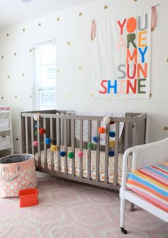Colorful and happy #nursery. Love the dots on the wall!