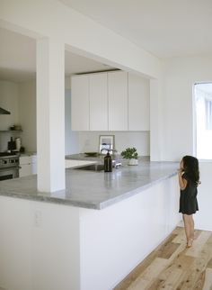 Our Kitchen Reno | Maria Lang | clean, white, open, modern | concrete countertops | support beam in countertops