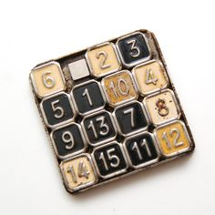 Old sliding number puzzle on Etsy