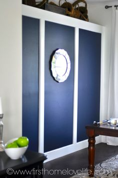 Navy blue with white trim.  Love the mirror. #NAVY #DININGROOM #DIY #PAINT