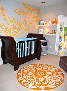 Adore these outrageous #orange patterns in this #modern #nursery.  #leafdecal #orangerug