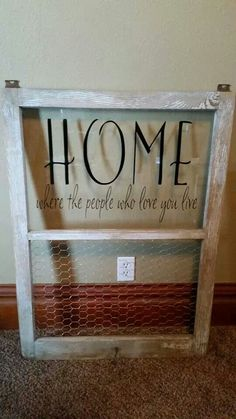 Old window with vinyl lettering. Chicken wire on the bottom to hang pictures.