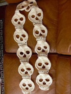 Crocheting: Day of the Dead Scarf.  With a little added embroidery, you could make the plain white skulls into cute, happy sugar skulls.