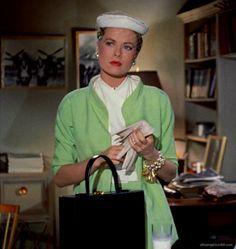 Grace Kelly, as Lisa Fremont in Rear Window.. Please note, the Mark Cross handbag ( her overnight case...)