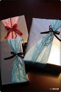 Wrap a gift with sheer ribbon like tuille or organza. Add metallic beads for pop of color.