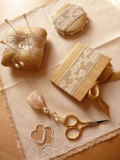 So pretty, would be a great gift for a stitching friend. Lace pinkeeper, pincushion and needlecase. This site is in French but the photos are beautiful - many ideas for using vintage textiles