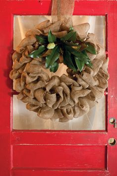 This rustic wreath was crafted using burlap