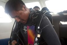 Angel Quim, of San Cristóbal, Galápagos Islands, Ecuador, prepares to lead divers on a check dive to test their skills under water before taking them to Kicker Rock, a popular dive spot right off the coast of the island. Quimi is a former fisherman who decided to leave his dangerous career and become a divemaster in 2000. Julia Wall/reesenews