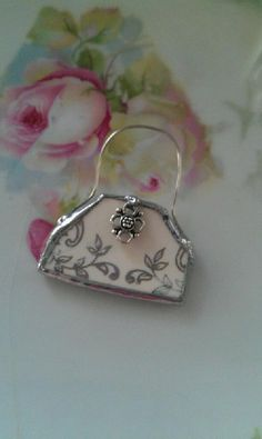 broken china soldered into a purse charm
