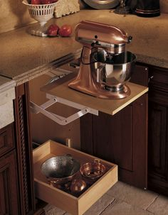 Pop-up cabinet so you can hide the mixer yet don't have to move it when you need it.